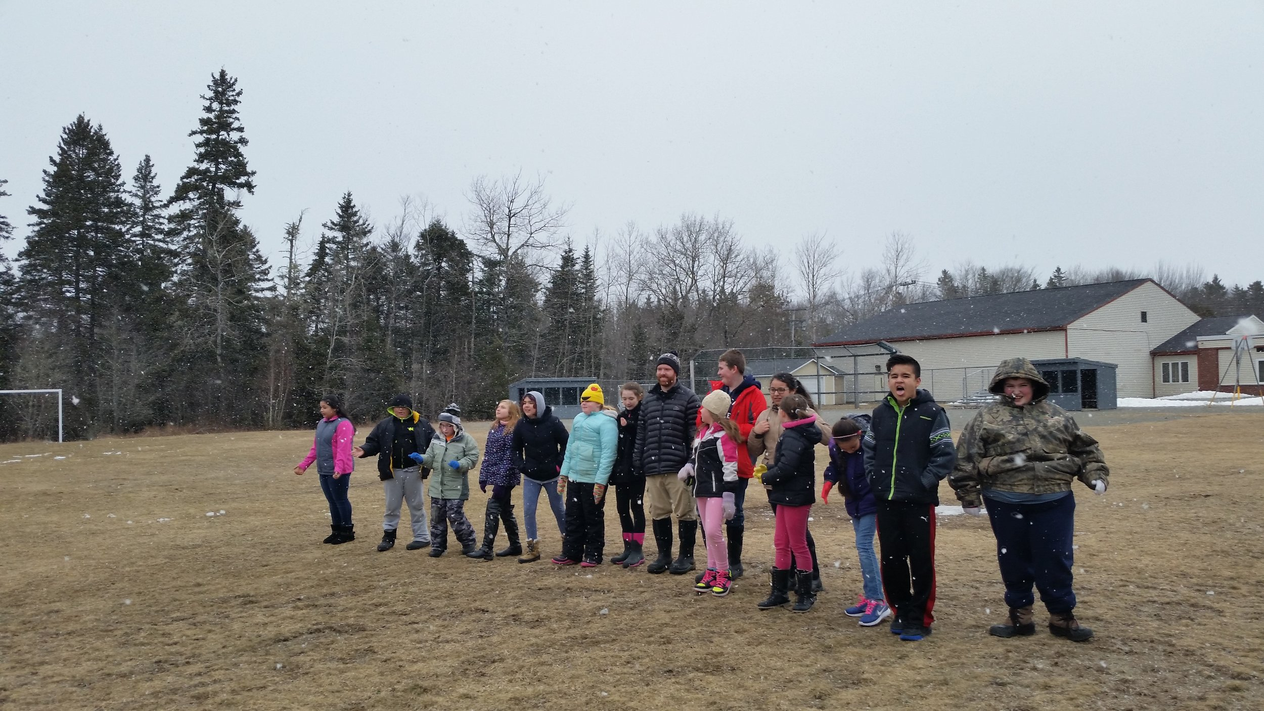 Milbridge students enjoying the snow and learning how resource availability affects populations