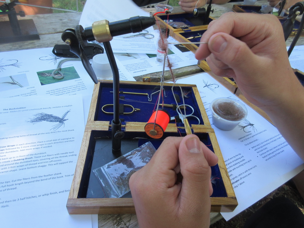 Working out the how to tie the complex Backstabber fly. Photo courtesy of Maria McMorrow.