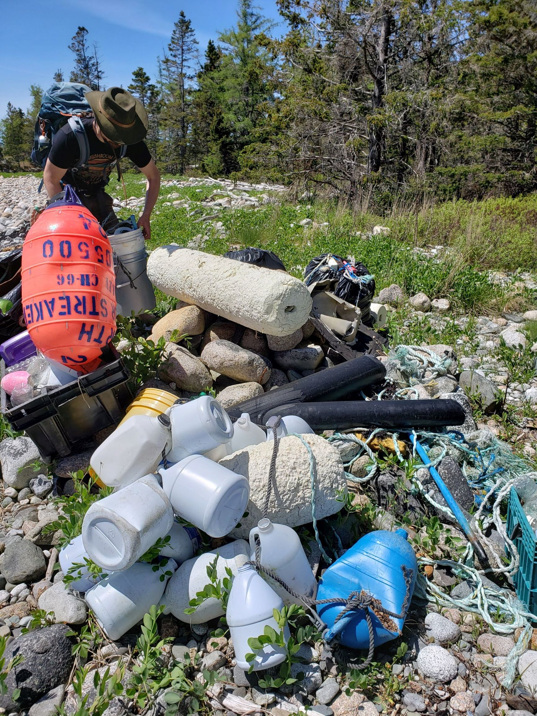 1 of 5 caches of trash we organized along the shore