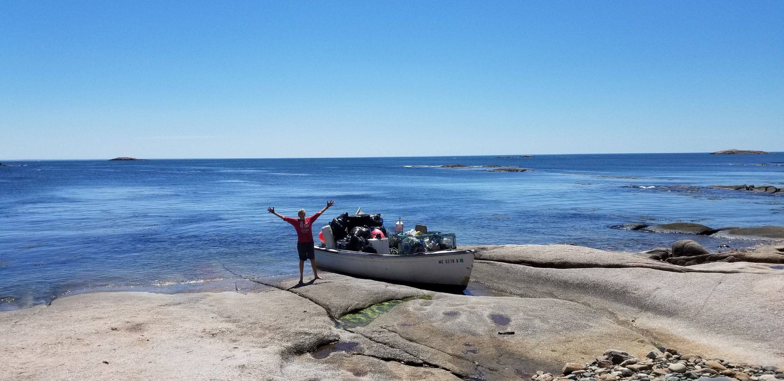 Donna Kausen with her boat full of trash ready to head to the mainland! Photo courtesy of Jon Keller.