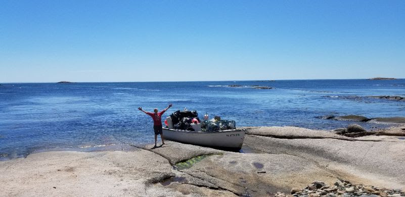 Donna Kausen with her boat full of trash! Photo courtesy of Jon Keller.