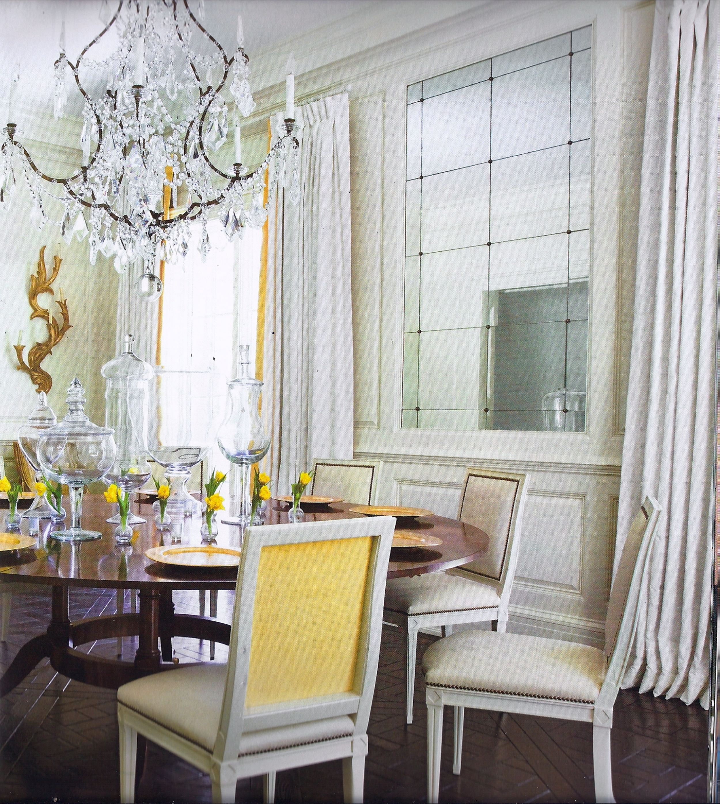 """I love the American design magazine   Veranda  . Click on the picture above for more from interior designer Melanie Turner. I love this dining room and the rest of the house in the cover story """"Comfortable Glamour"""", September 2010. The yellow contrast back fabric is so fresh yet sophisticated. Just a little punch of color."""
