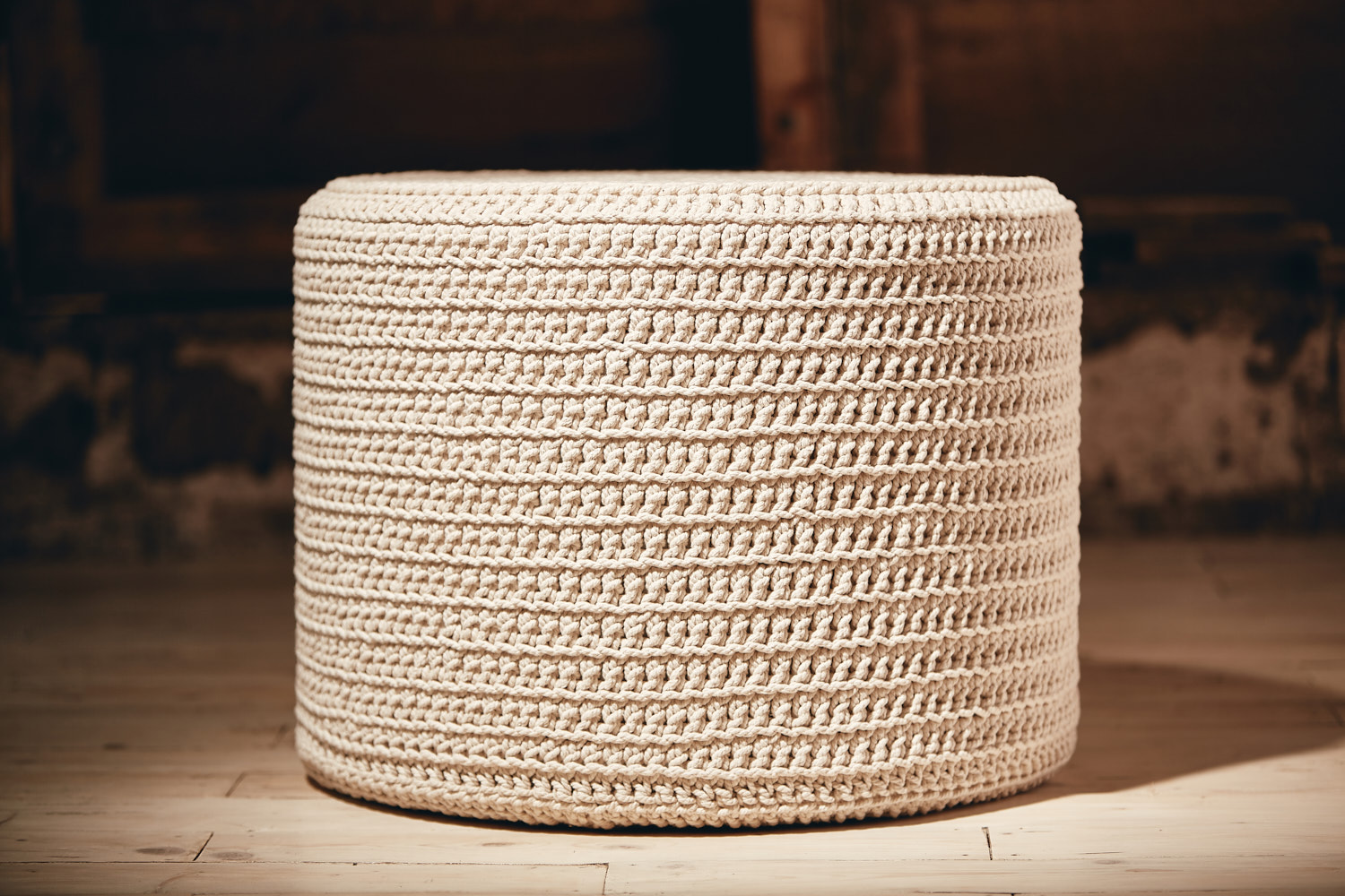 ROUND OTTOMAN   Recycled Cotton (chunky) D600mm x H450mm  High density foam inner cushion, base board, removable fabric lining, hand-crocheted cover