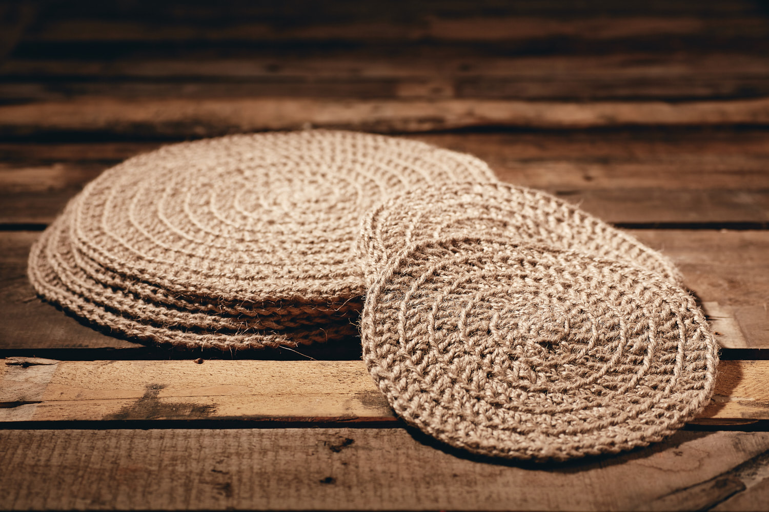 PLACEMATS - SMALL  Eco Twine Set of 4  Hand-crocheted placemats Approximately 23cm in diameter.