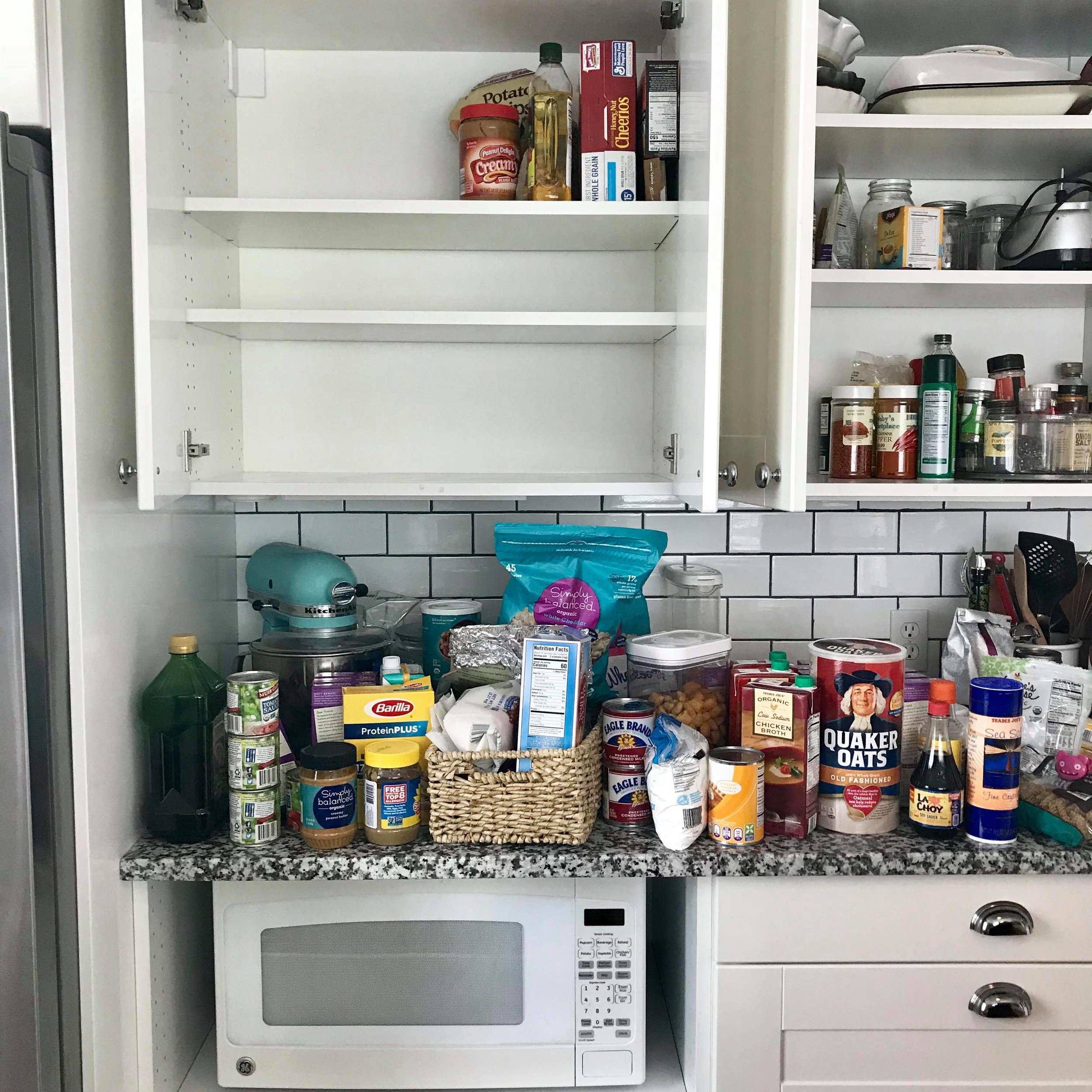 before - My plan here was1 / to empty out our pantry cabinets. 2 / Toss expired food & giveaway food we don't use.3 / Identify foods I should have in my pantry (particularly ones that I could stock up on & not need to constantly rebuy)4 / Put things back in a way that is easy to access
