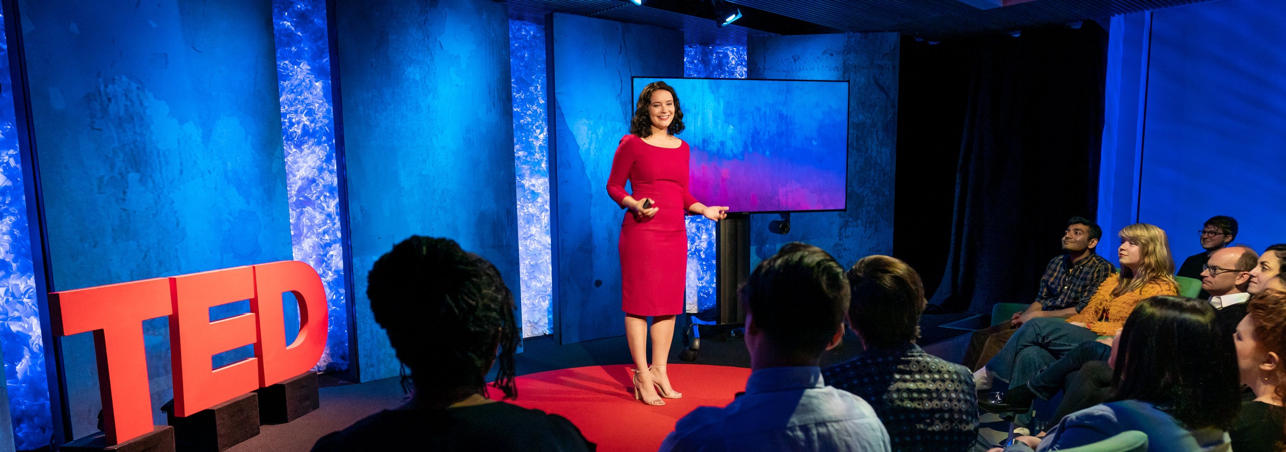 Our CEO Jessica Ochoa Hendrix giving a talk on the TED stage