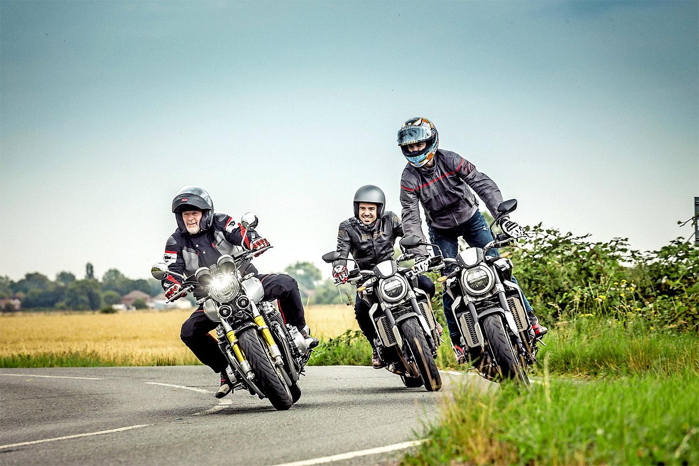 3 bike riders 1 stand.jpg