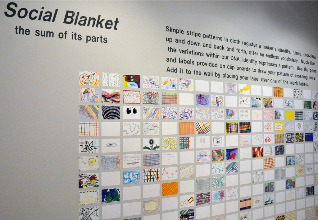 Social Blanket   ,   wood, polyester voile fabric, adhesive labels, markers, cups, clipboards, vinyl letters, 7 feet, 6.75 inches, x 12 feet, 6 inches x 6 feet, (bench), ink stain on oak plywood