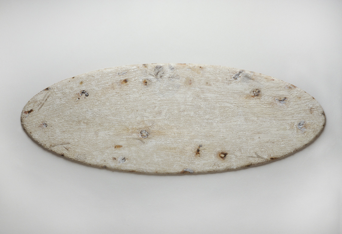 mundi , burned industrial felt, acrylic, oil, wax, photo transfers, 20 x 54 x 1 inches, 1994