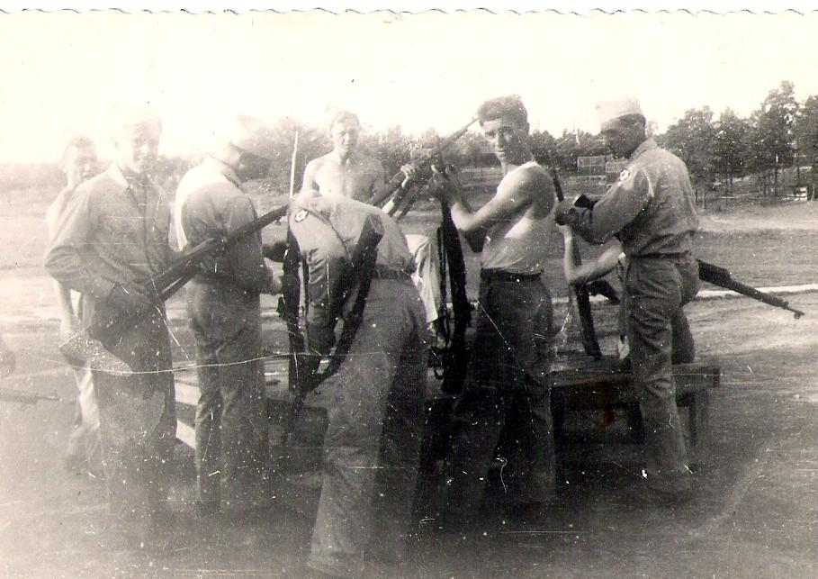 Men at the rifle range.