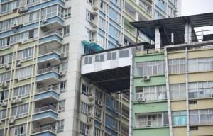 illegal-corridor-bridge-highrise-nanning-china-designboom-01