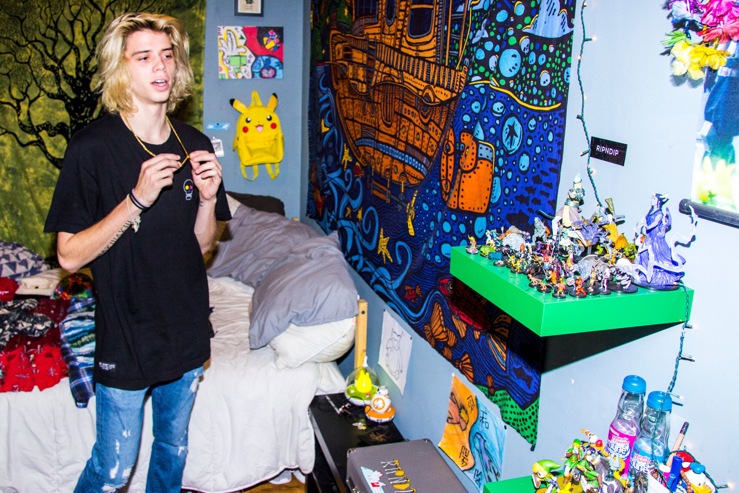 Austin is fascinated by Japanese and Anime culture and loves to paint his take on them. Also pictured: his dungeons and dragons figurines.