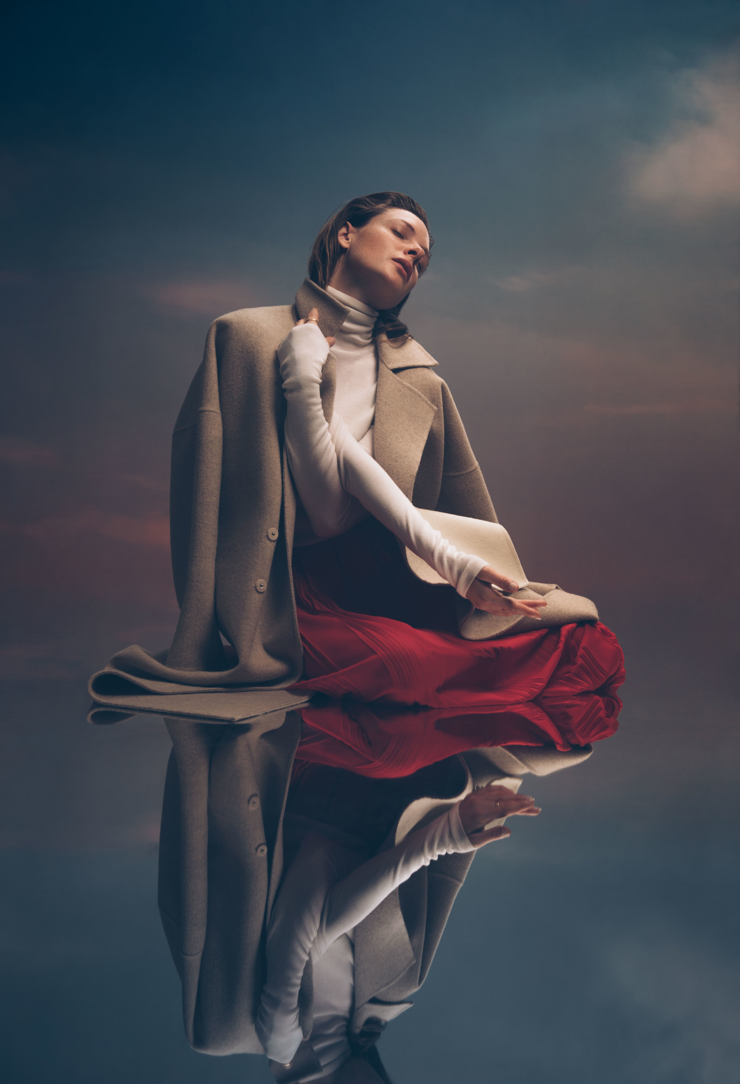 all images shot by Crown & Owls | FASHION CREDITS:  REJINA PYO  coat,  VIONNET  turtleneck and skirt,  SOPHIA WEBSTER  shoes,  ALIGHIERI  pinky ring (worn throughout), and  EKRIA  rings