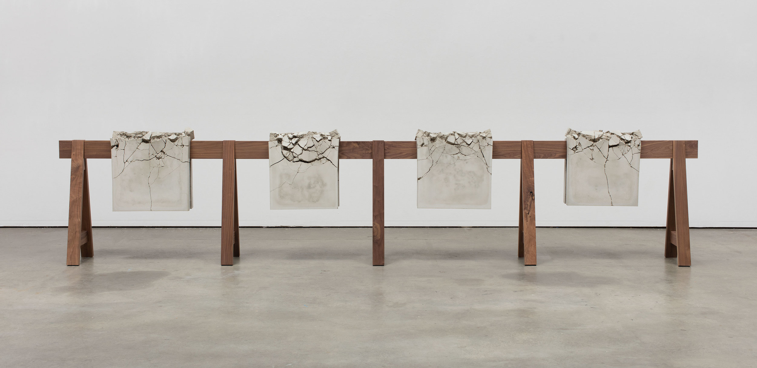 """Analia Saban. """"Draped Concrete"""" (2016). Four concrete slabs on wooden sawhorse. 104,8 x 487,7 x 42,9 41 CENTIMETERS. 1/4 x 192 x 16 7/8 INCHES Courtesy the artist and Sprüth Magers Photo: Brian Forrest"""