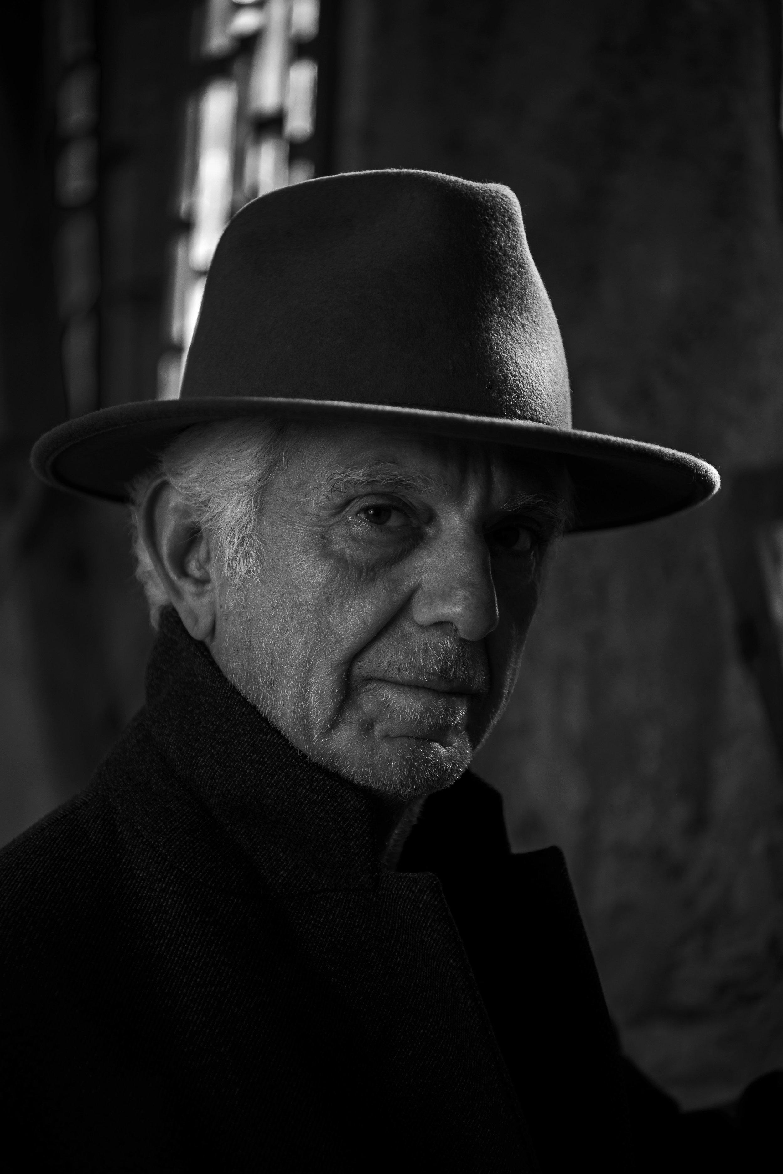 Maurice Marciano    photos by Ian Morrison   Fashion credits:   ERMENEGILDO ZEGNA COUTURE  coat and  JOSETTE & BERNARD  hat.