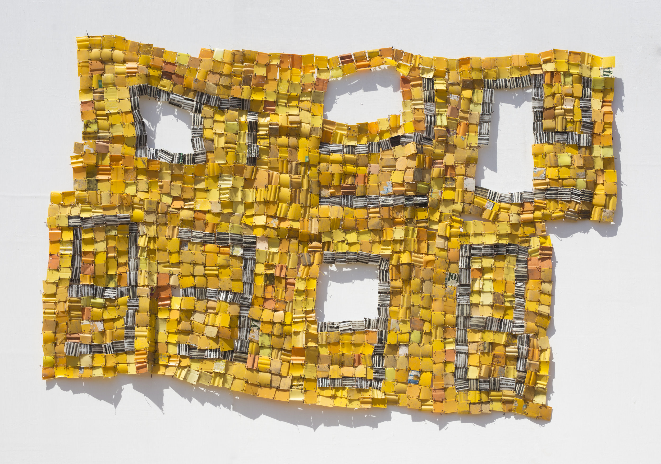 """SERGE ATTUKWEI CLOTTEY. """"NOTHING ELSE MATTERS"""" (2018). PLASTICS, WIRES AND OIL PAINT. 53 X 88 IN. PHOTO: NII ODZENMA."""