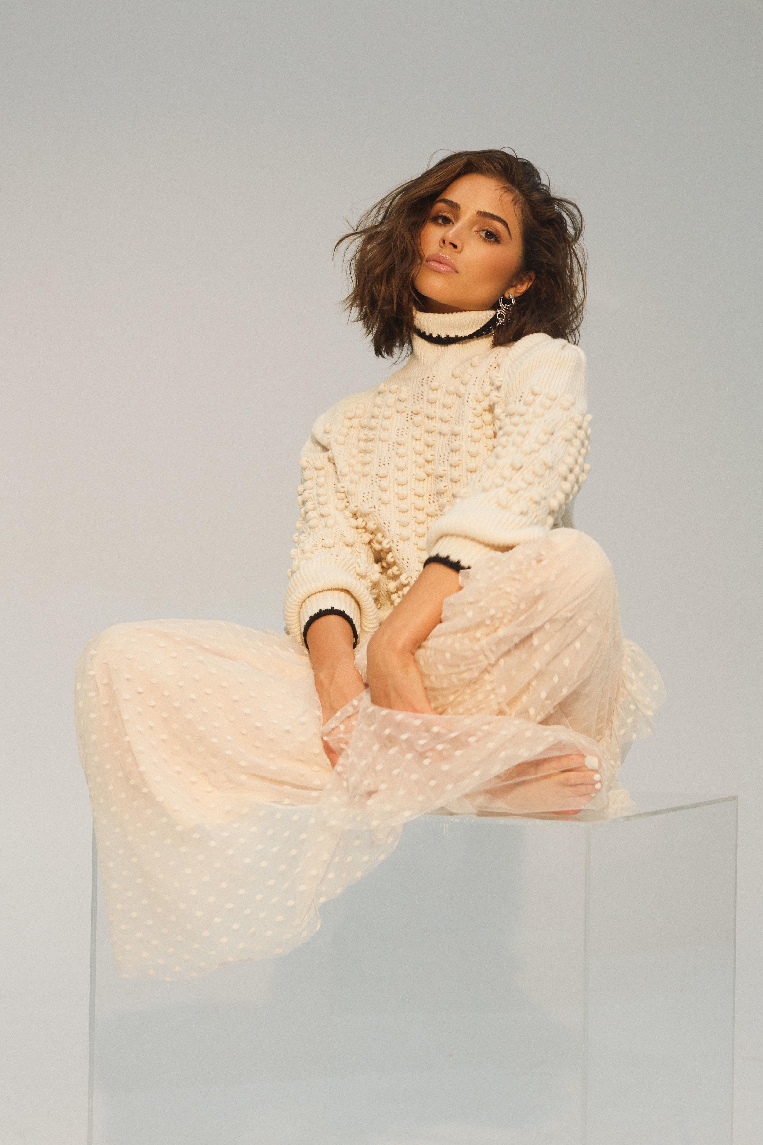 BCBGMAXAZRIA     sweater, skirt, and earrings.