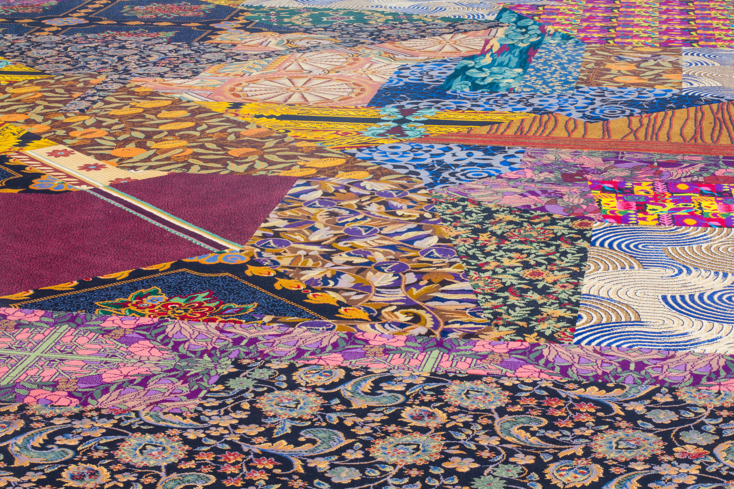 """CAYETANO FERRER. DETAIL, """"REMNANT RECOMPOSITION"""" (2014). CASINO CARPET FRAGMENTS AND SEAM TAPE. COURTESY THE ARTIST."""