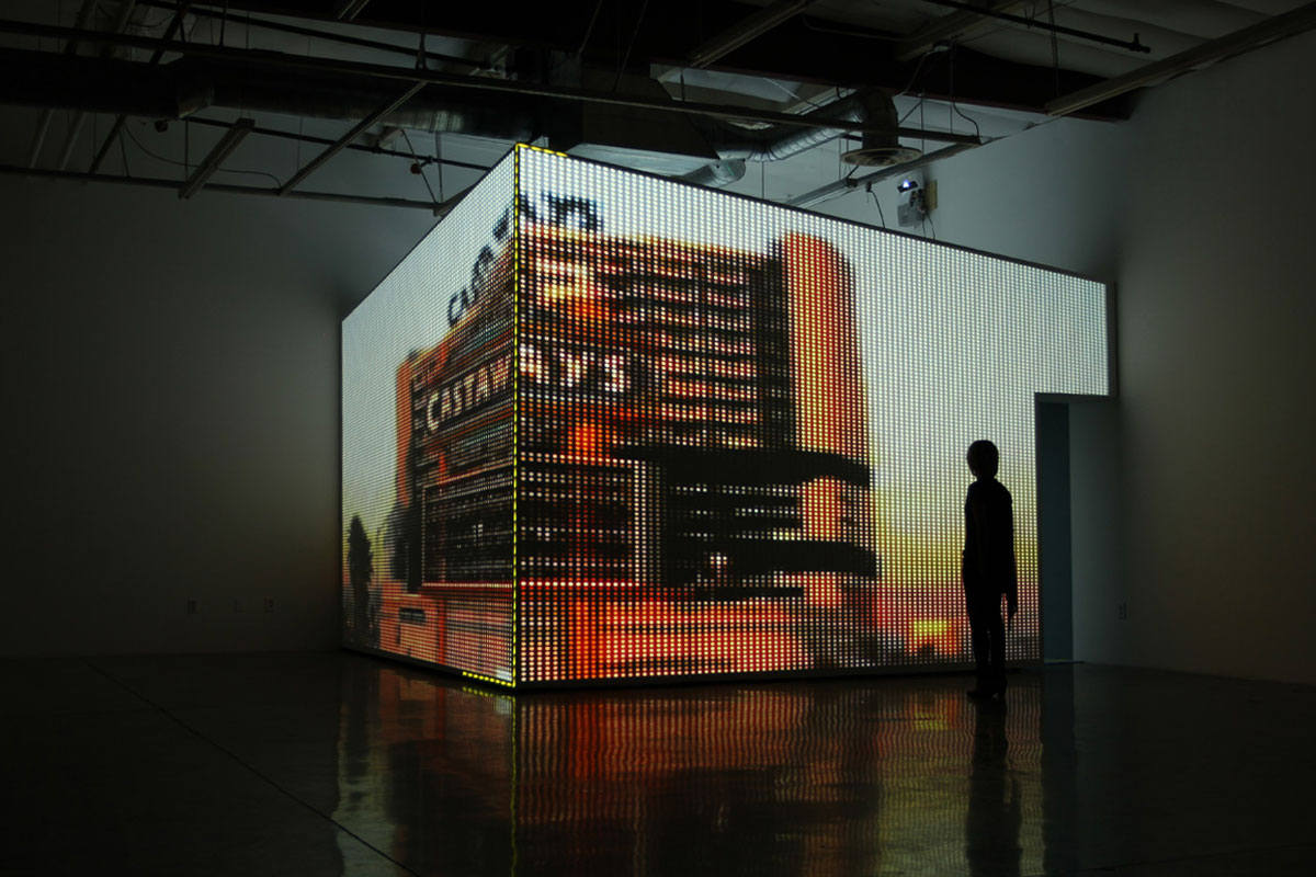 """CAYETANO FERRER. INSTALLATION DETAIL, """"CASINO MODEL 3"""" (2010). DRYWALL ROOM, CEILING TILES, HD PROJECTIONS, DYE- SUBLIMATED PRINT ON CARPET. DIMENSIONS VARIABLE. COURTESY THE ARTIST."""
