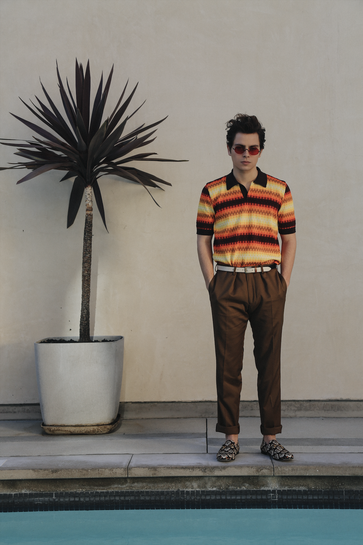 DRIES VAN NOTEN   shirt,   THE KOOPLES   pants, GUCCI shoes,   URBAN OUTFITTERS   belt, and stylist's own sunglasses.