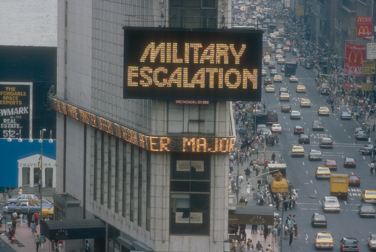 Above:  Gretchen Bender,  Military Escalation-Dare to be Stupid , 1986. Computer Animation / Spectacolor Light Board. Part of  Messages to the Public  exhibition in March, 1986. Photo: Jane Dickson. Courtesy of Public Art Fund.