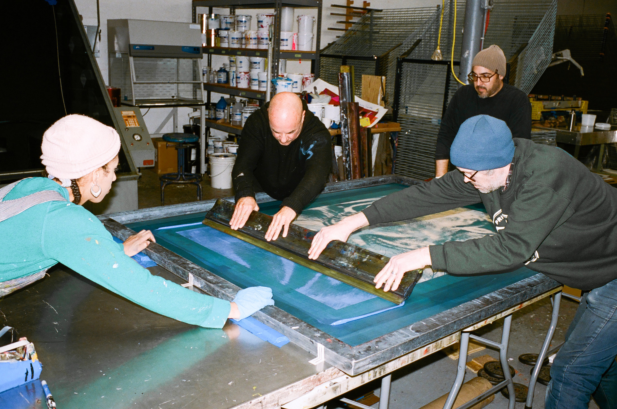 Russell and Luther in the silk-screen printing process.