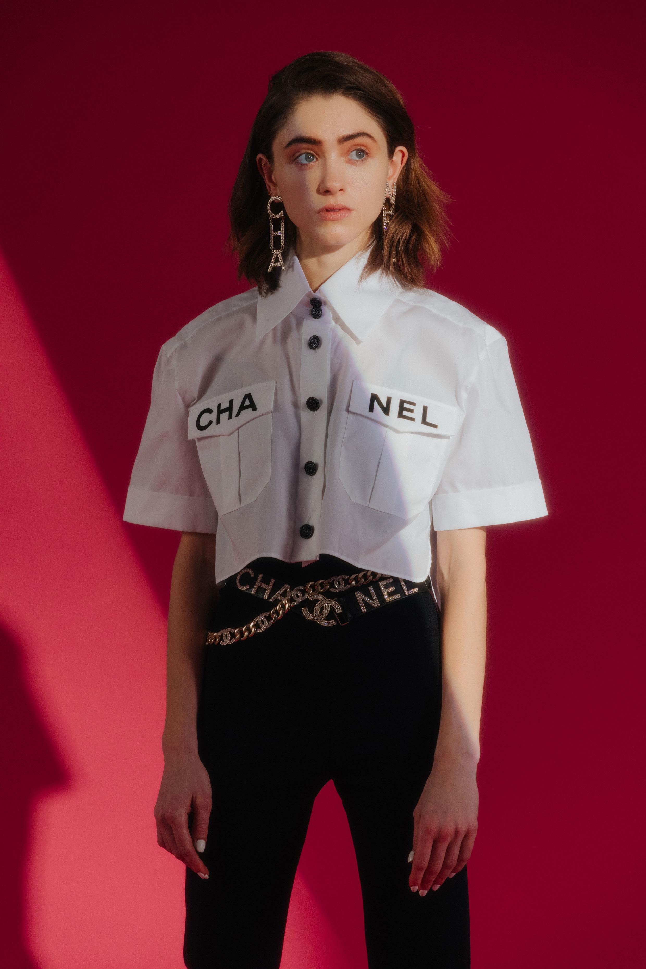 CHANEL  shirt, pants, belt, and earrings.
