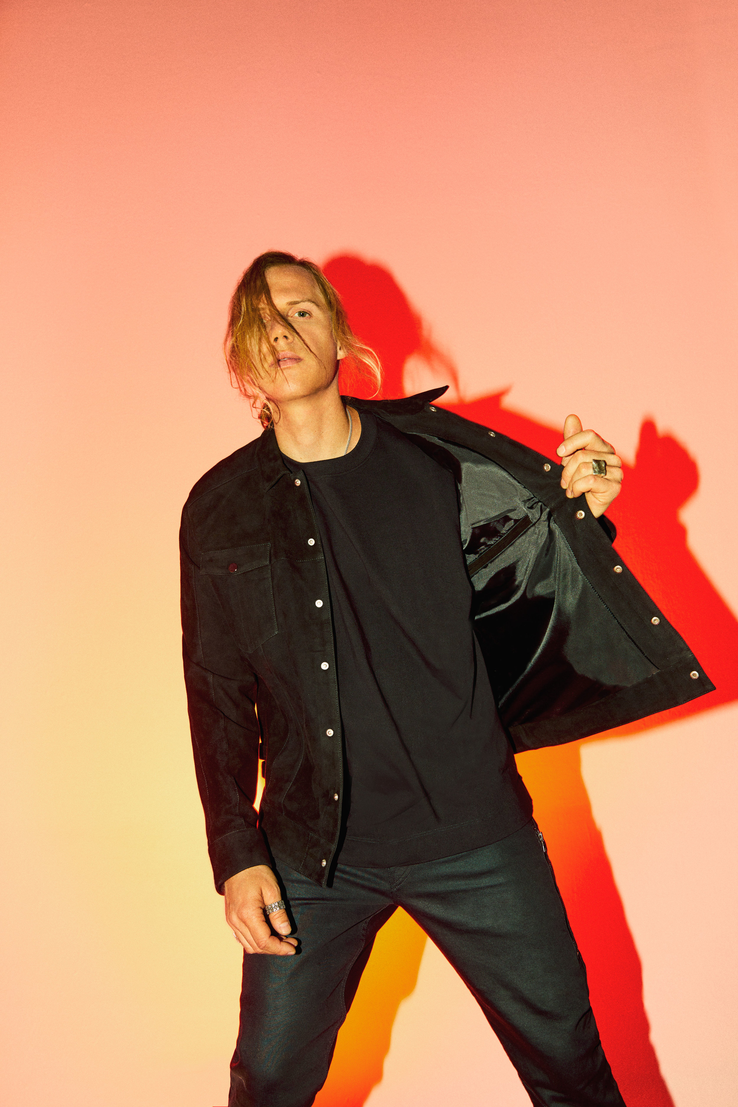 VITALY   jacket and jewelry,   RICK OWENS   t-shirt, and   AG     pants.