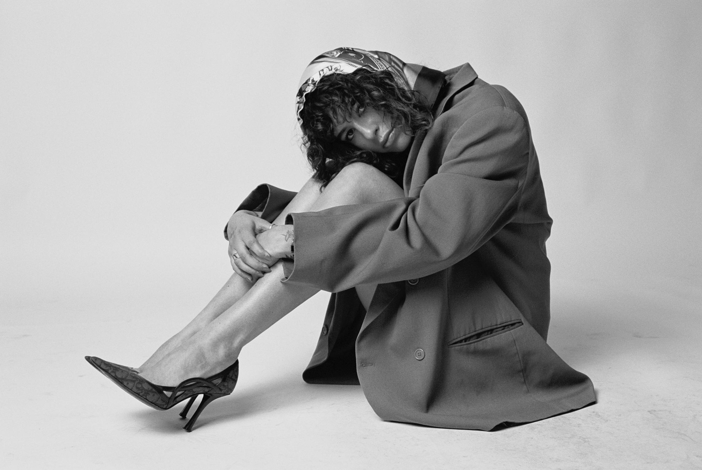 CURVE   scarf,  VINTAGE  blazer,   FLEUR DU MAL   top,  AYM  shorts, and  VINTAGE DIOR  heels.