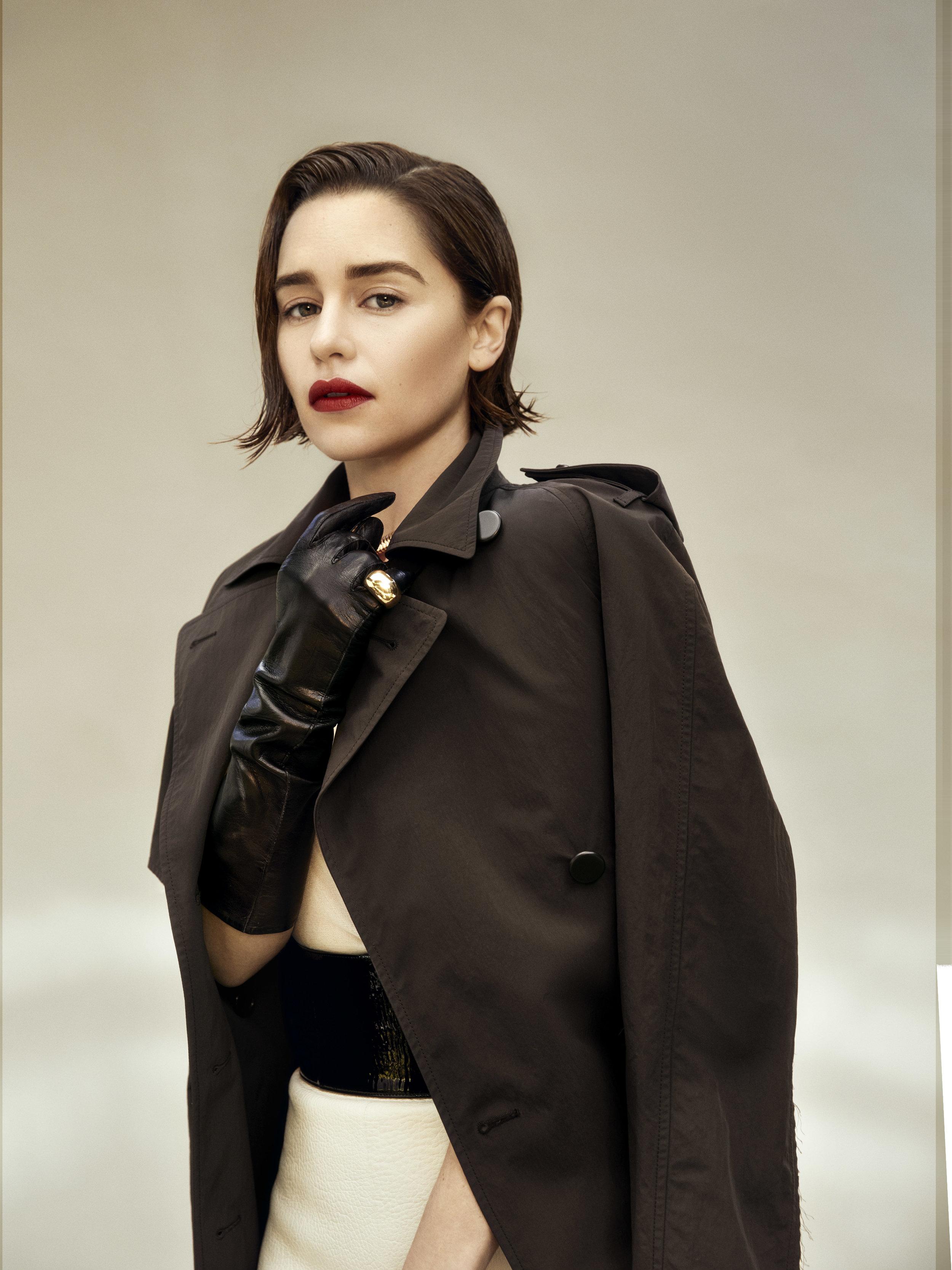 BOTTEGA VENETA   coat, top, and skirt,   LACRASIA     gloves,   BVLGARI     Serpenti necklace, and     CARTIER   Goldmaster De Cartier ring.