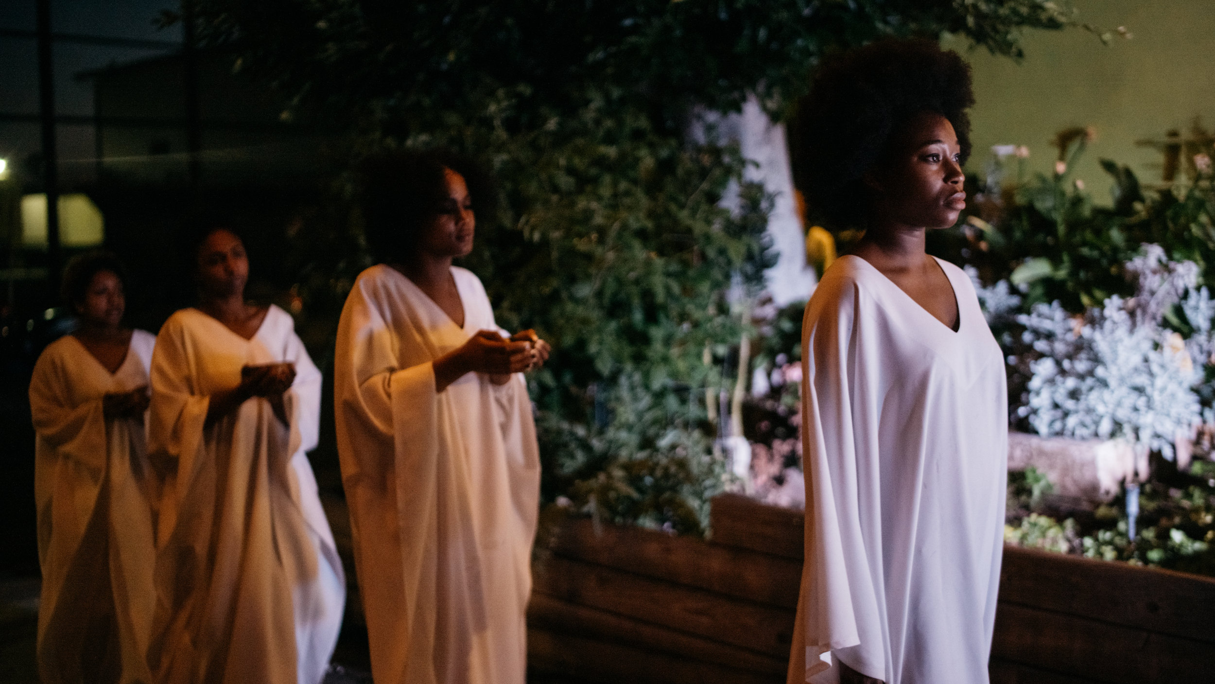 Each  Hairwash  performer walks in white robes towards their destiny.