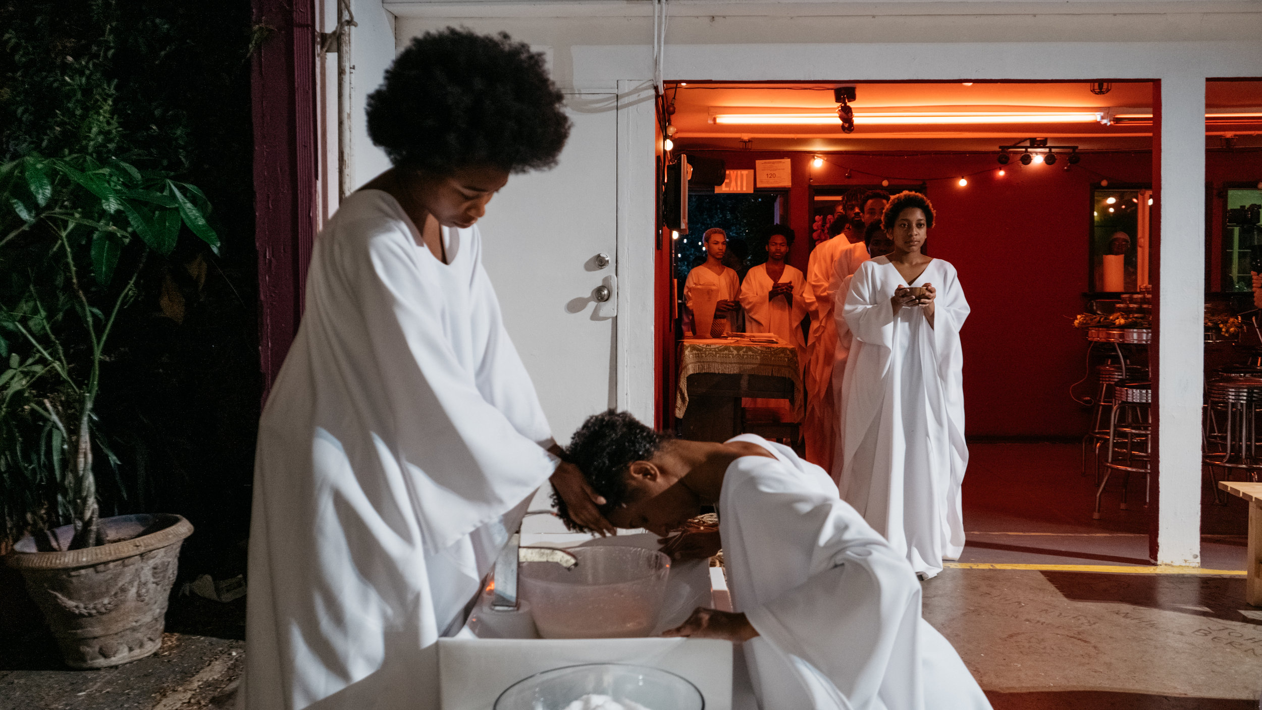 We kneel in reverence of our hair. Our natural hair historically scoffed at is now seen as a blessing.