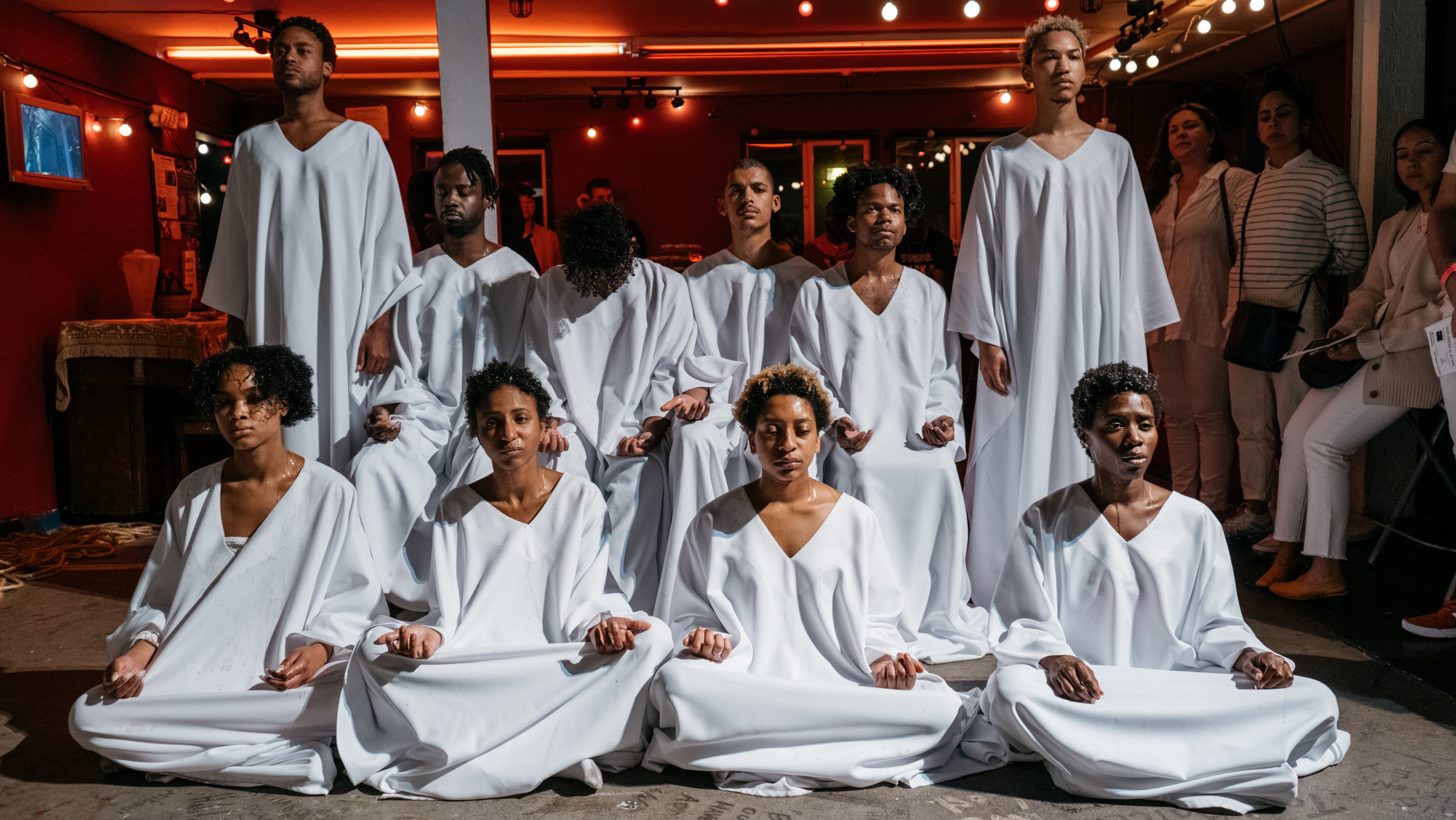 All Black bodies. All white robes. Healing collectively.