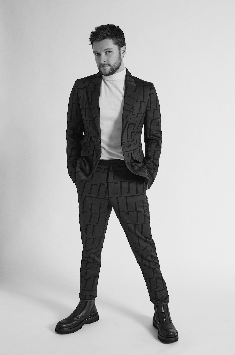 ERMENEGILDO ZEGNA   suit and boots and   BOTTEGA VENETA   turtleneck.