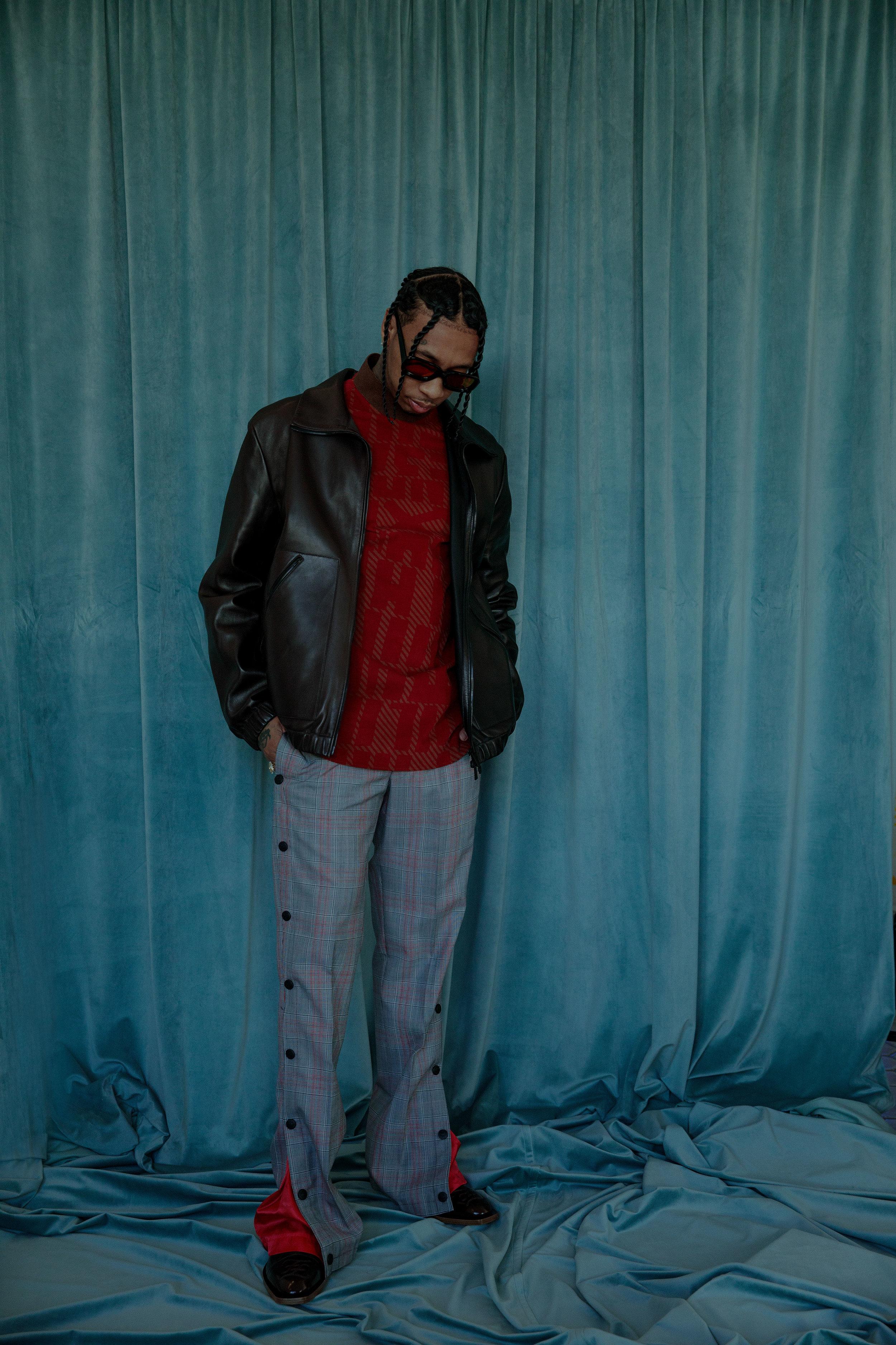 FENDI   jacket and boots,   ERMENEGILDO ZEGNA XXX   sweater,   MCM   pants, and   FAIRFAX OPTICAL LAB   sunglasses.