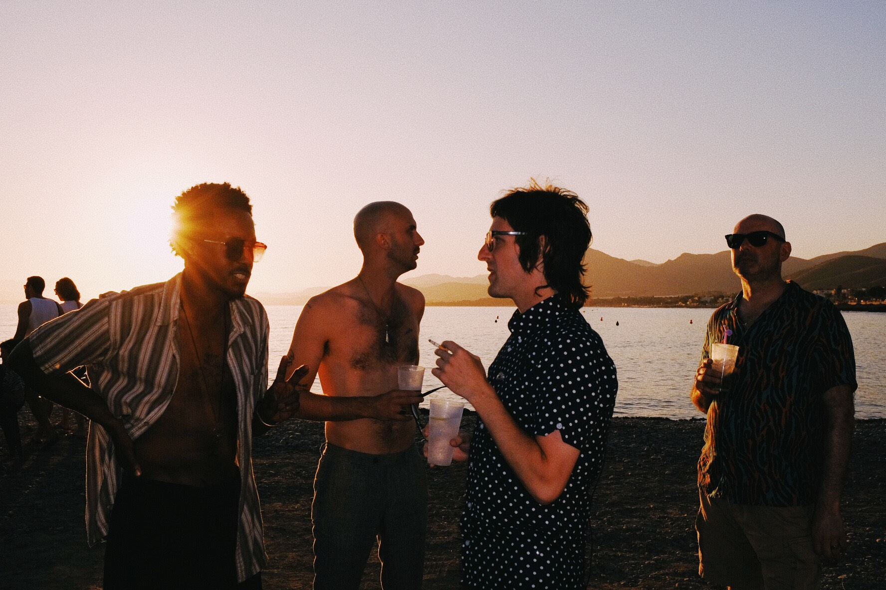 """Band (minus Travis) at sunset & my amazing tour manager Pete Smith. La Azohia, Spain."""