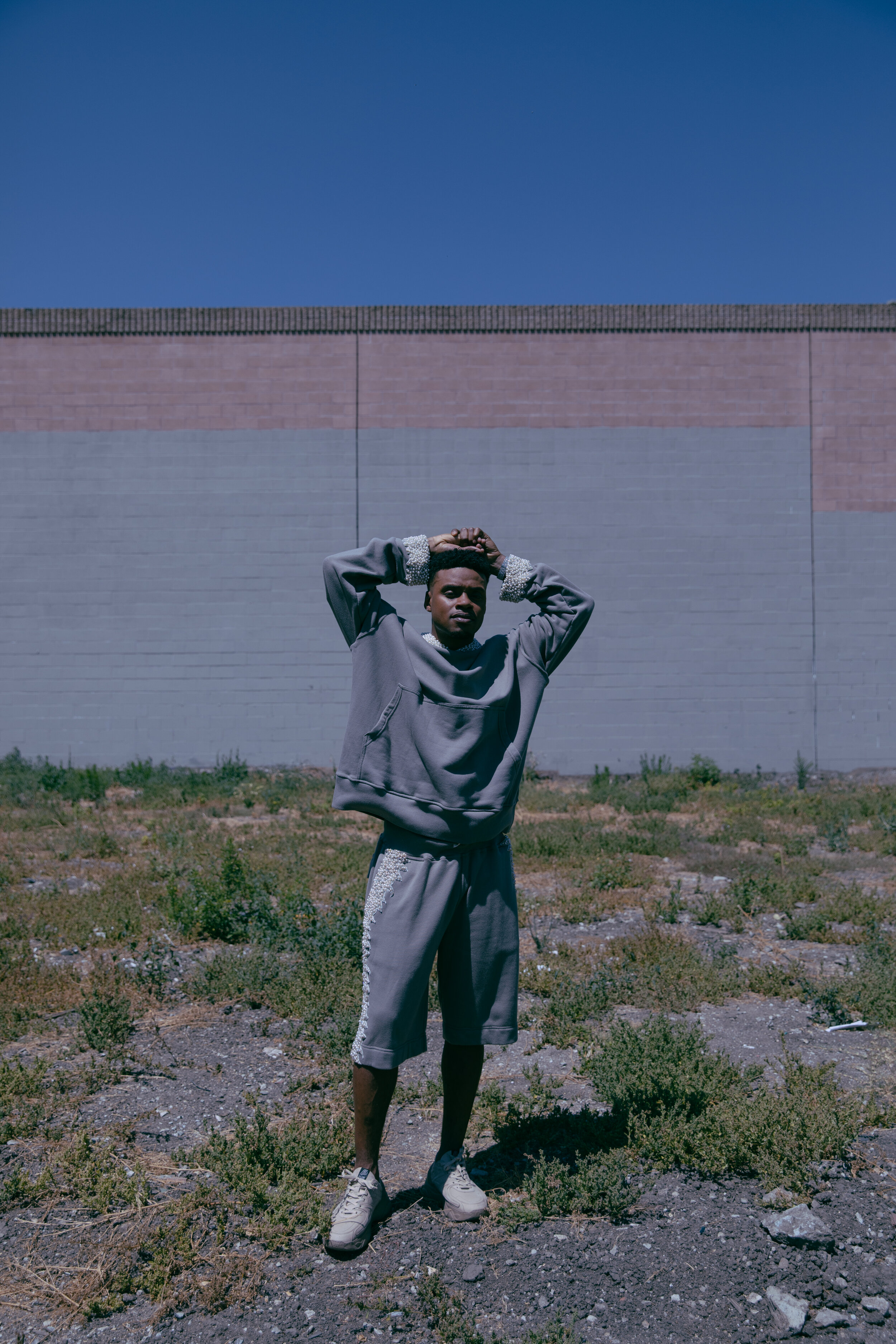 BRAYDON ALEXANDER   sweater and shorts and   FILLING PIECES   shoes.