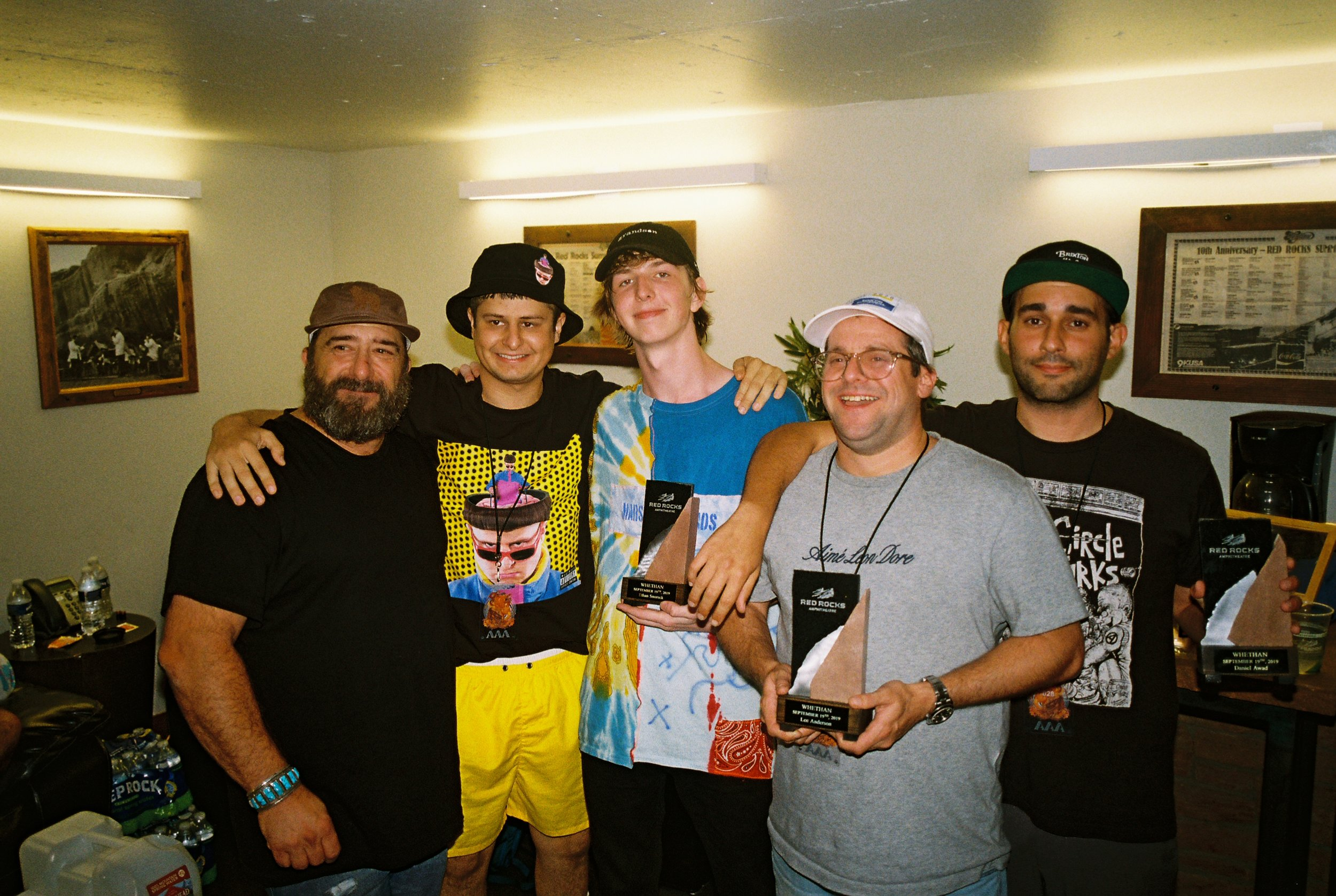 oliver tree, me, lee (agent) and dan (manager) getting a piece of the rock after selling out red rocks tradition   Photo by Tak Kamihagi