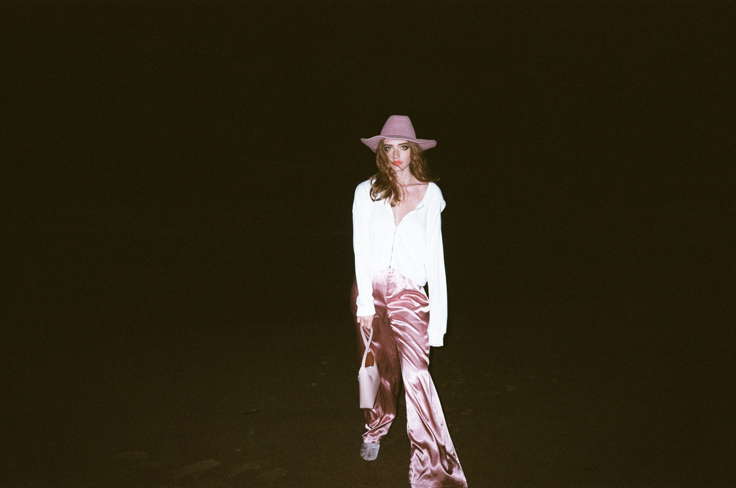 CLYDE   hat ,    TIBI   shoes,   IMAGO-A   bag, and   WOLF CIRCUS   necklace.