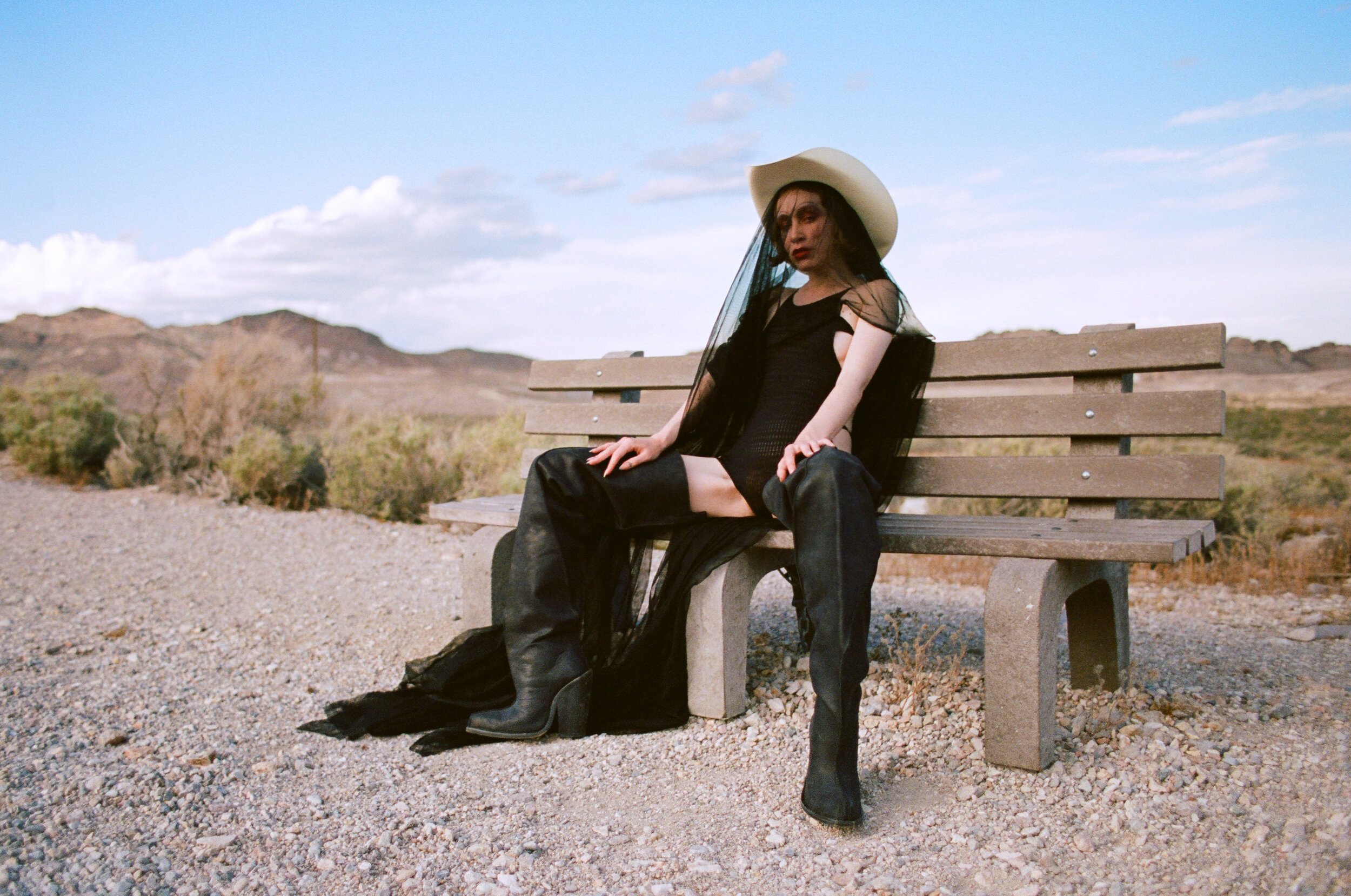 RUI ZHOU   bodysuit,   HARDEMAN   boots, and stylist's own hat.