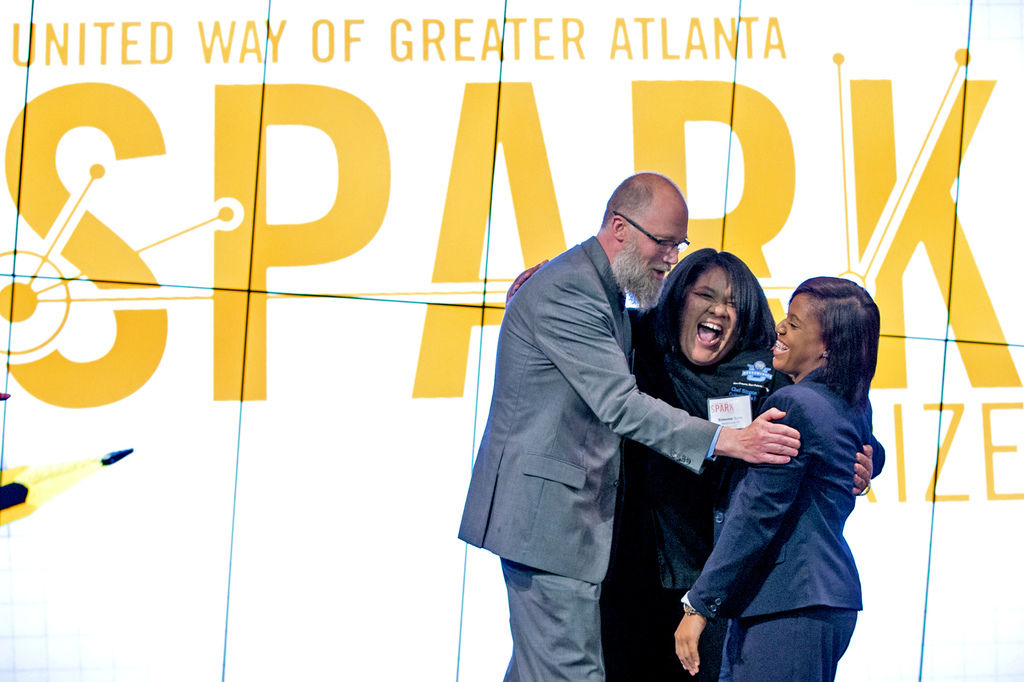 April 28, 2016: Gwinnett Daily Post-CARE Closet co-founder Lauren Seroyer (right) reacts to winning the United Way of Greater Atlanta inaugural SPARK Prize to fight community issues. (PHOTO: Chris Roughgarden)
