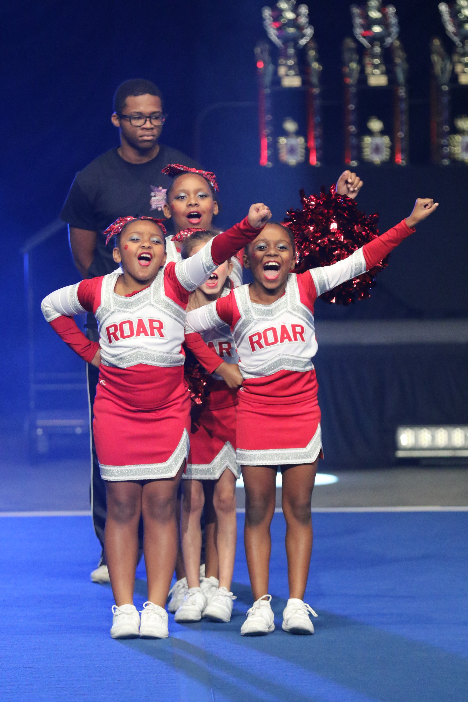 Our Mission - To empower the next generation of female leaders by using the platform of competitive cheer to enhance the lives of girls and young women in the communities of Harlem and the Bronx.Learn More