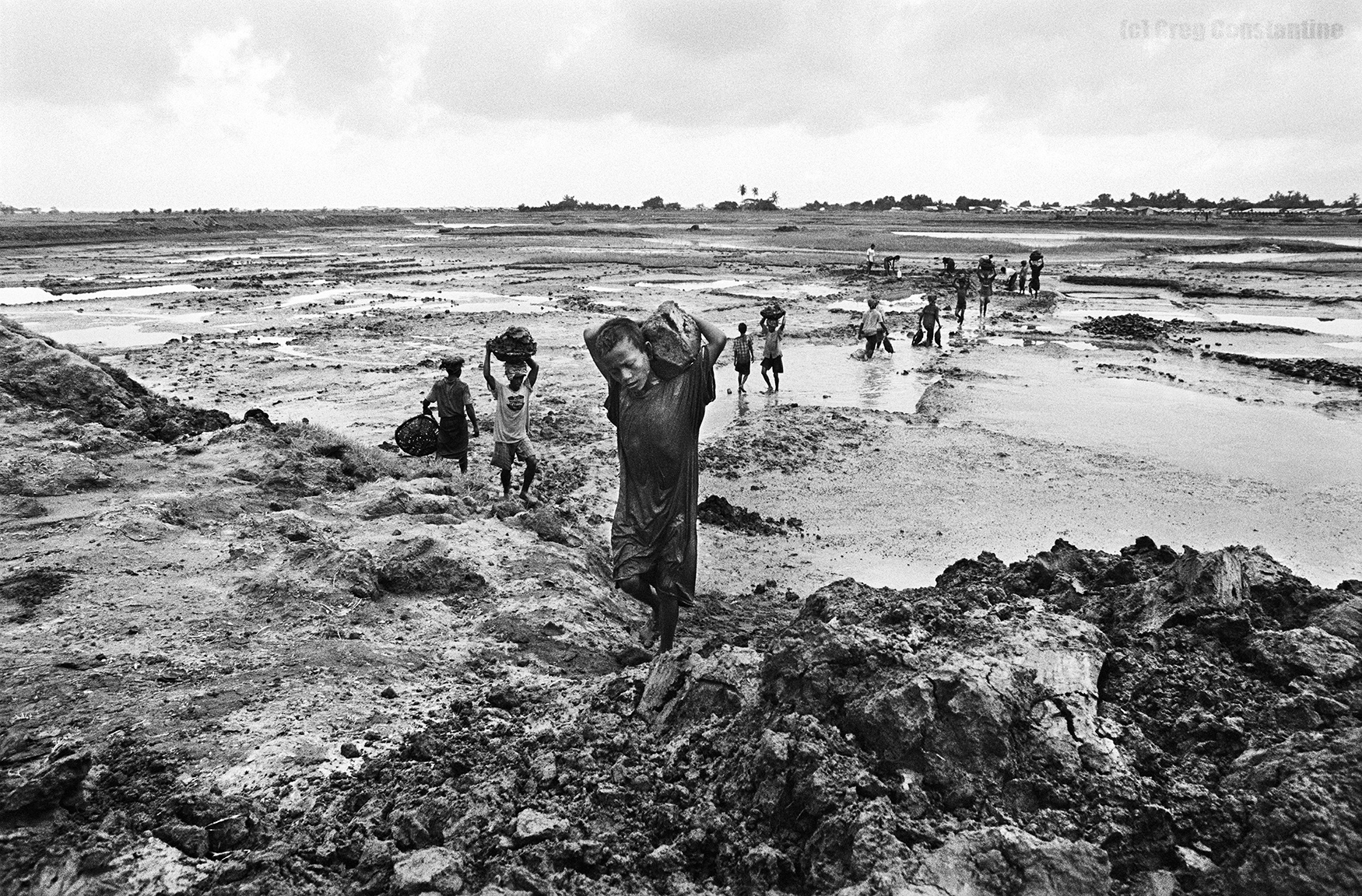 Rohingya feel a generation of children will not receive an education. Seven-year-old Nur hauls mud at a worksite near one of the IDP  [internally displaced person]   camps.