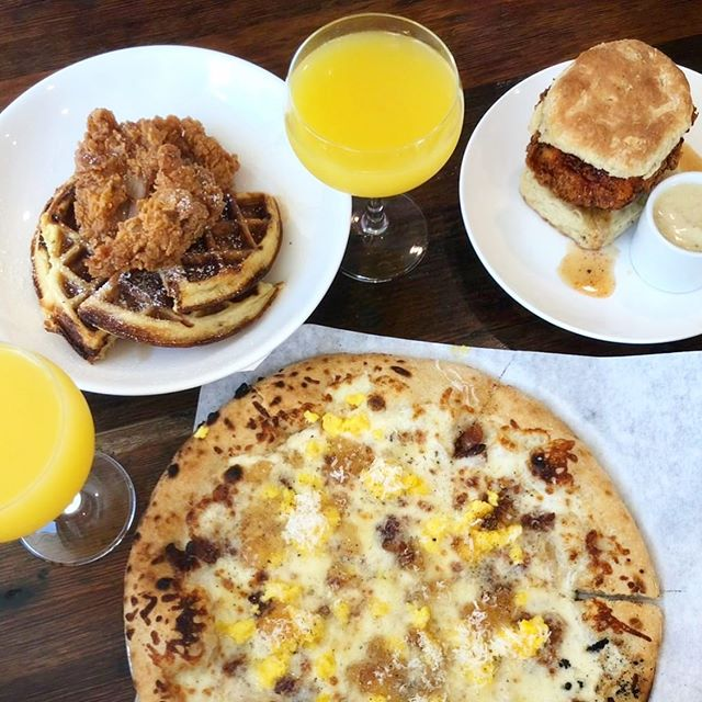 #SUNDAYBRUNCH 🍾🍊🥞🍳🥓🍓 It's our favorite meal of the week!  What's better than #bottomlessmimosas🥂& our breakfast pizza: cheesy scrambled eggs 🍳 bacon 🥓 apple jelly, truffle, parmesan and cracked pepper. This is the brunch menu favorite you didn't know you needed! Or our rabbit + waffles...or any of our fluffy biscuit sandwiches...you get the picture! See y'all tomorrow! . . #brunch #boozeybrunch #breakfastpizza #champagne #cheers #sundayfunday