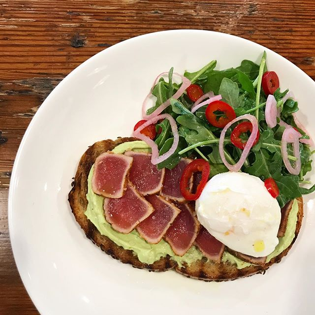 📣Calling ALL #Basic B!&*#es!📣 We have #avacadotoast on the #brunch menu today!!🥑🍞 • grilled rye bread • avocado purée • seared sushi grade tuna • poached egg • pickled shallots & chilis • arugula