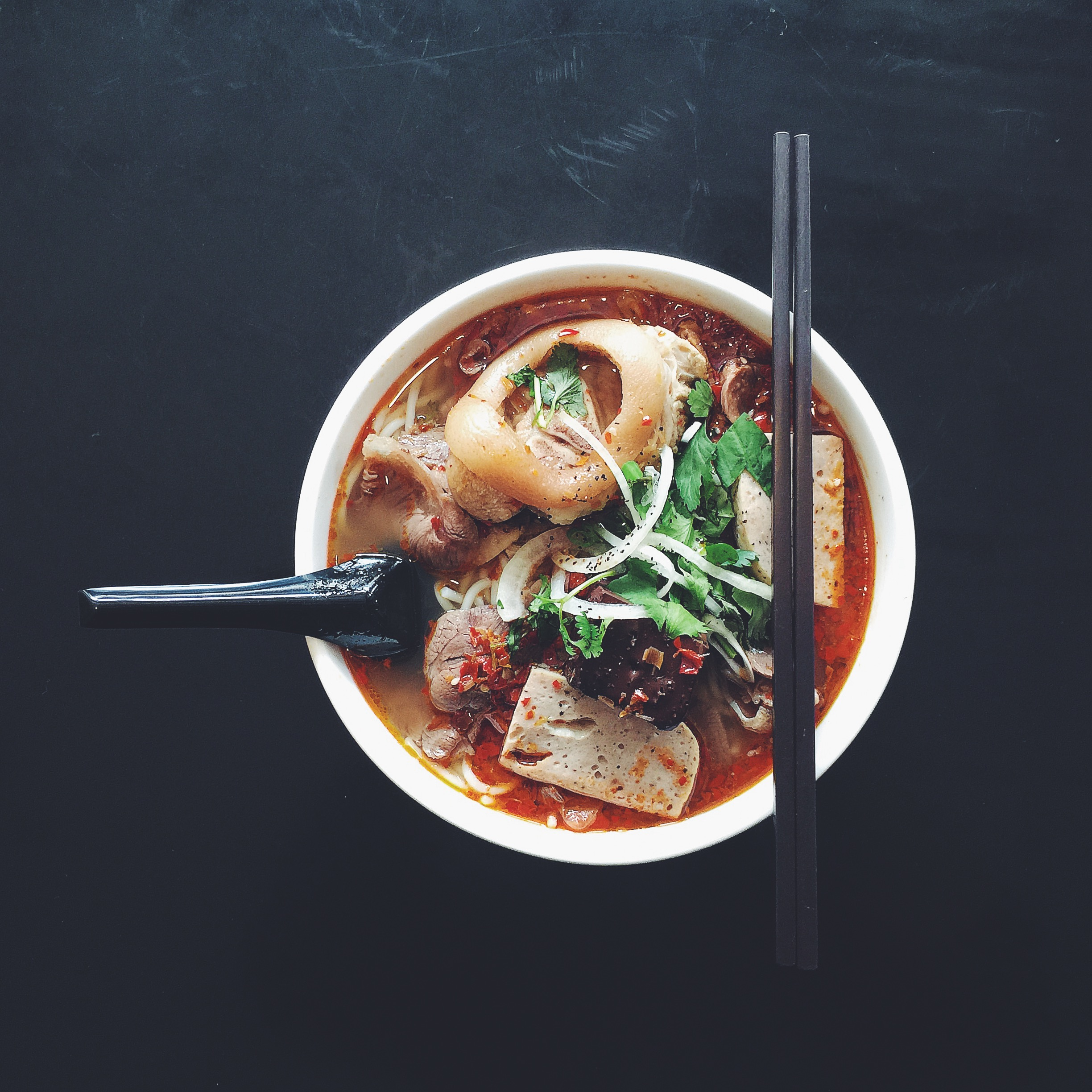Bún Bò Huế, a complex pork and beef bone soup that reflects the diverse culinary heritage of central Vietnam.