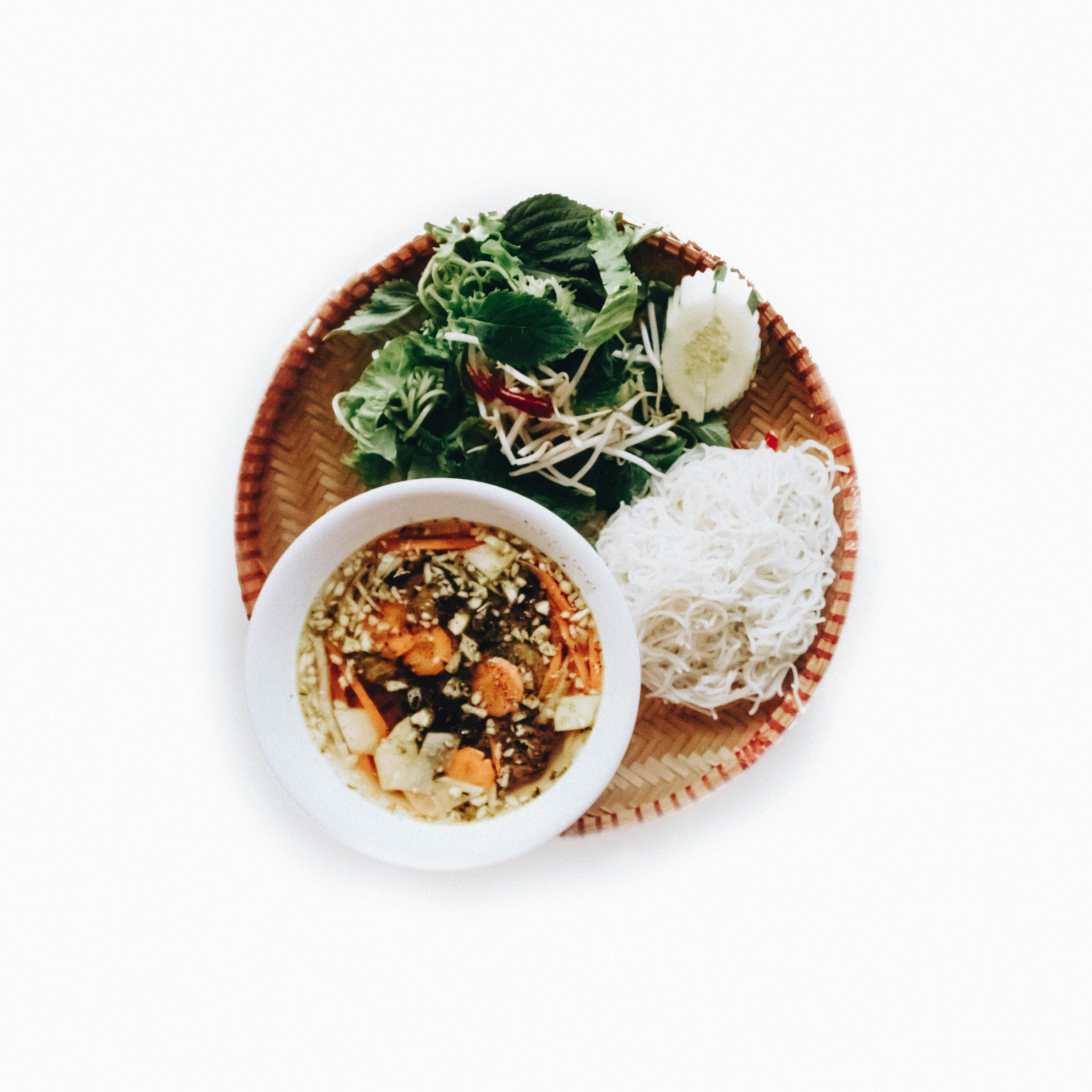 Bún Chả Hà Nội, a rustic vermicelli noodle dish paired with chargrilled pieces of sweet and savory pork belly and patties basking in a light fish sauce broth