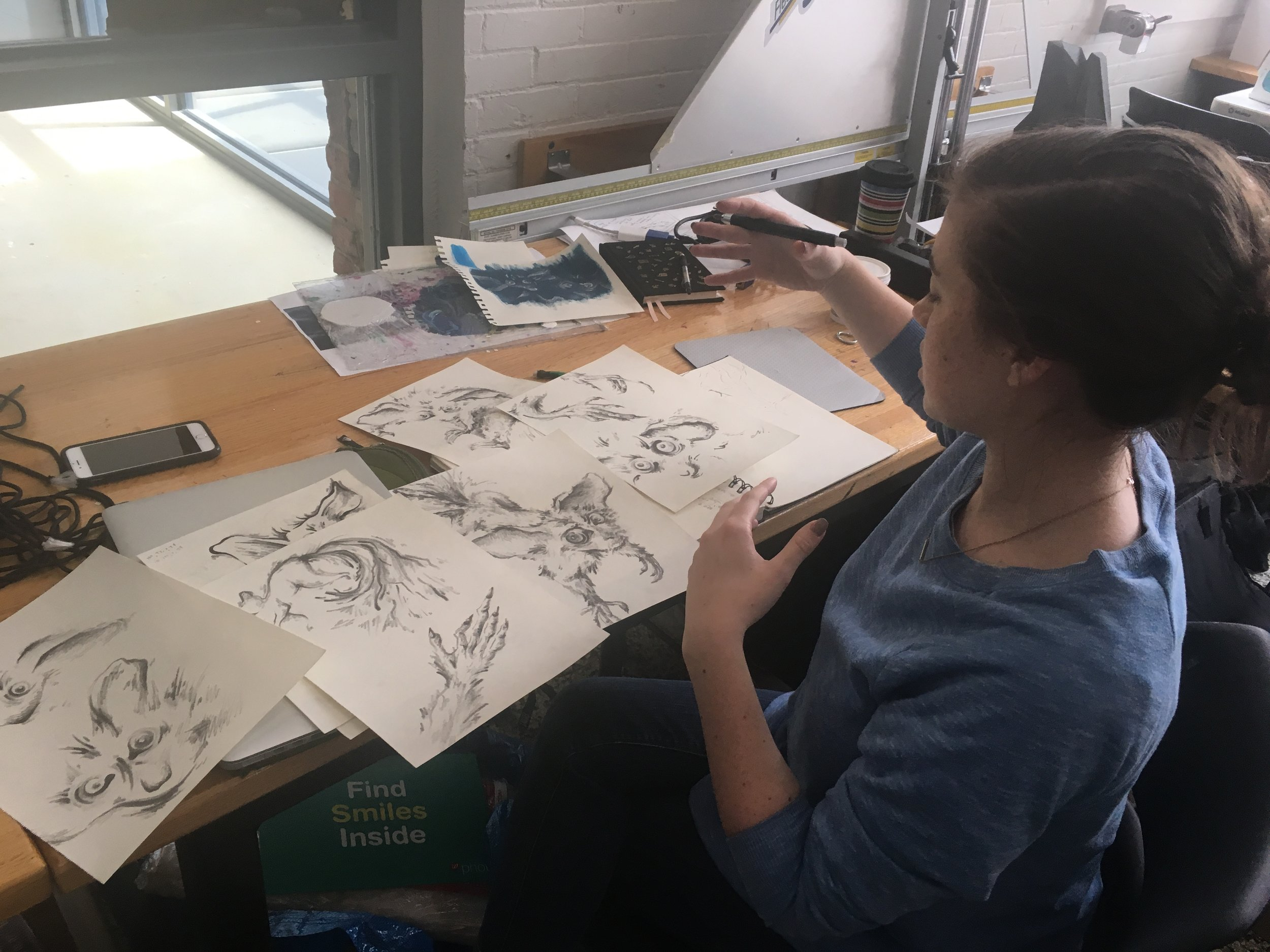 Sarah Albright sketching aye-aye graphics for the piece.