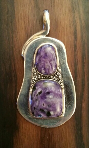 """Two luscious charoites separated by granulation with contemporary bail design. Measures 3"""" x 1.5"""". $119"""