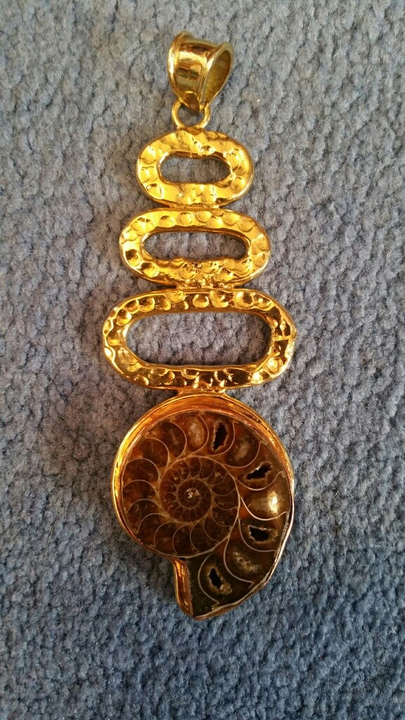 """Striking ammonite in raised copper setting. 3.75"""" tall, 1.5"""" at widest."""